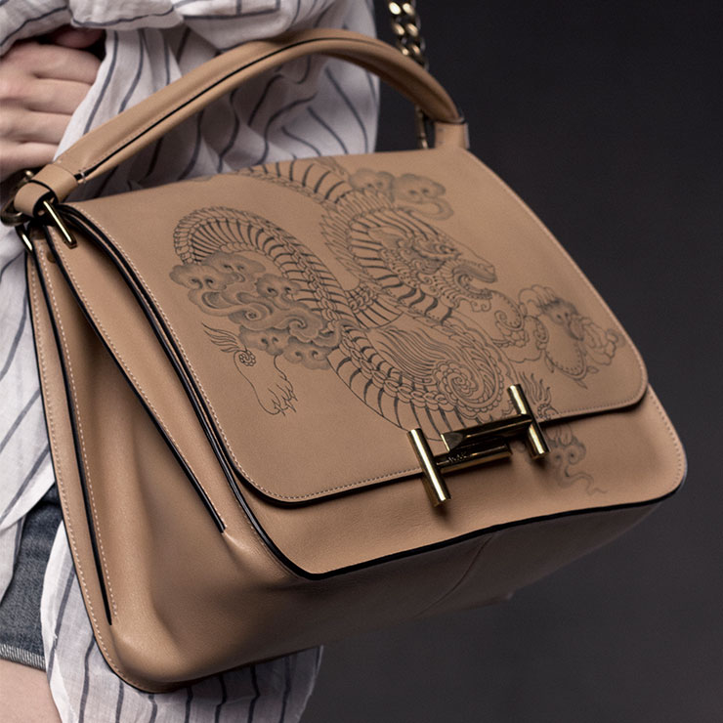 Double T handbag. Tod's cooperates with the famous tattooist