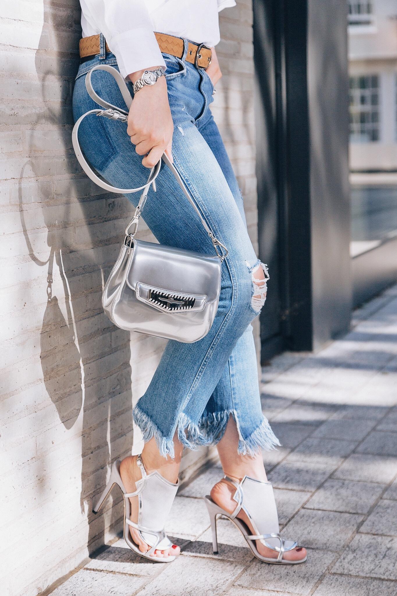 Silver designer handbag