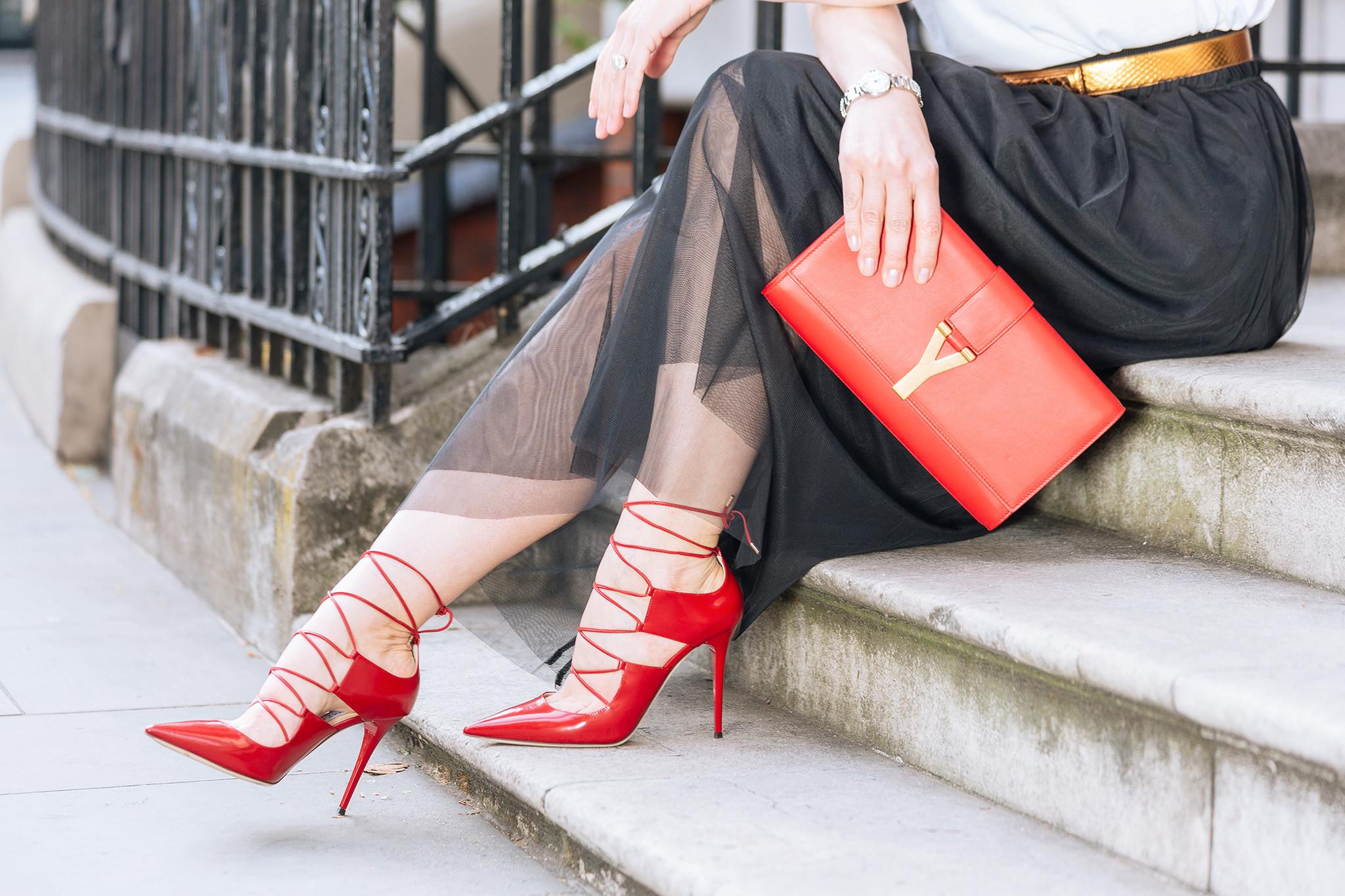 Jimmy Choo red shoes, long black tulle skirt