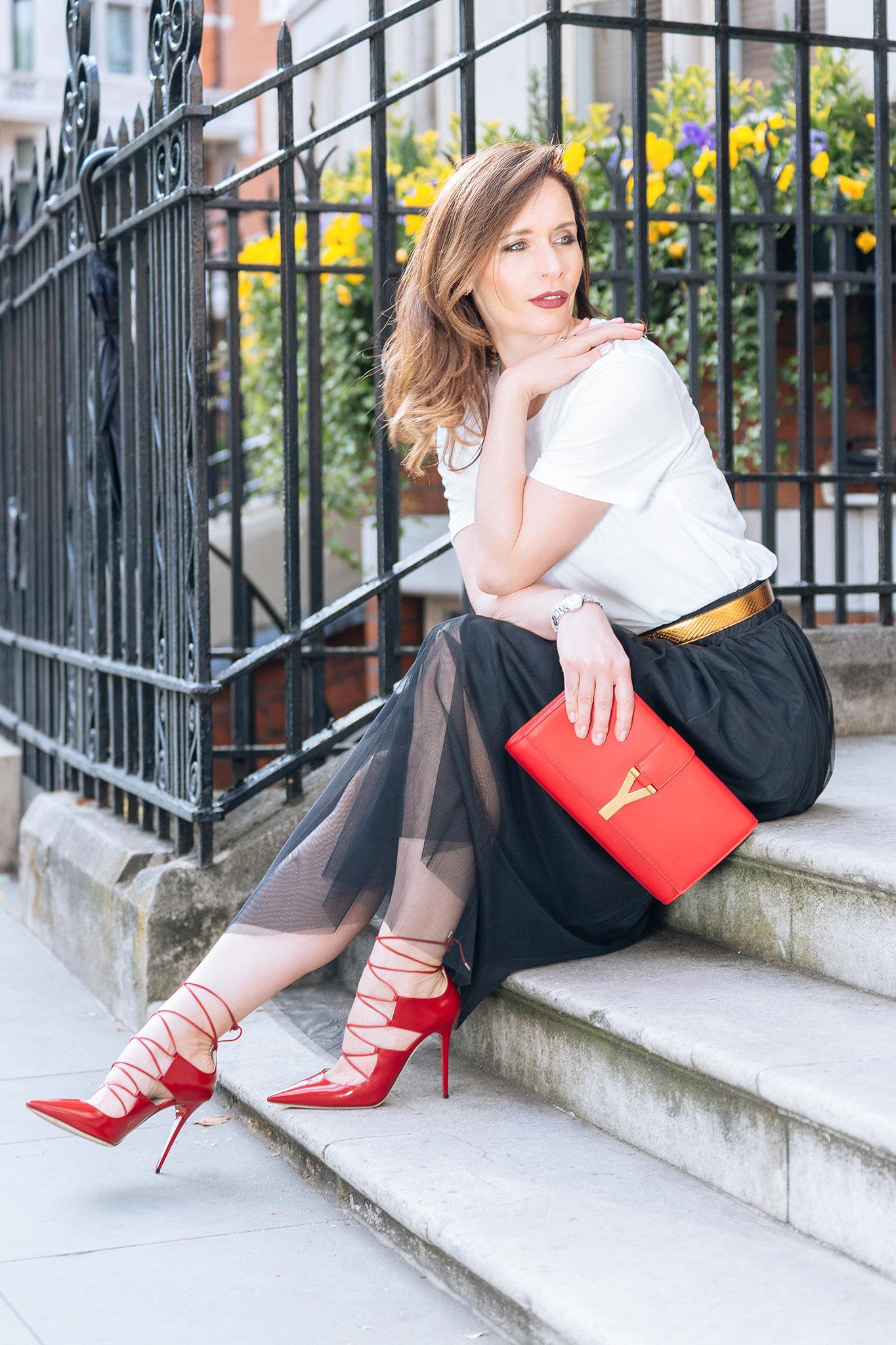 black tulle skirt, red Jimmy Choo heels