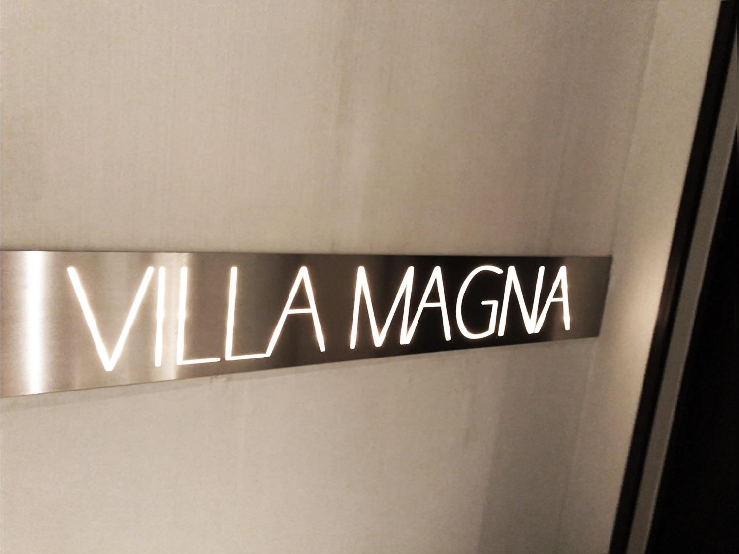Villa Magna hotel sign in restaurant