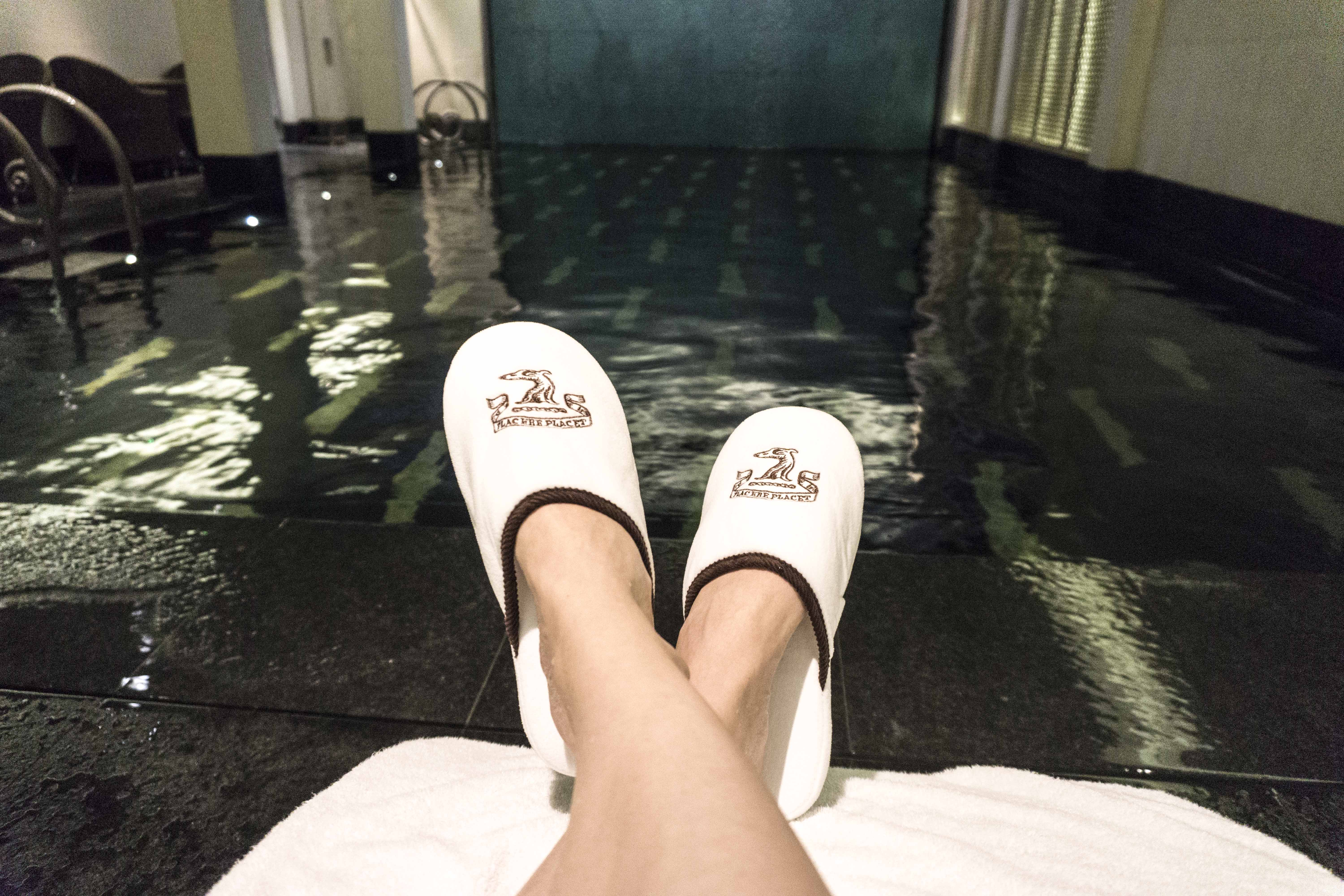 Petra from Chic Journal relaxing by the pool at The Connaught hotel
