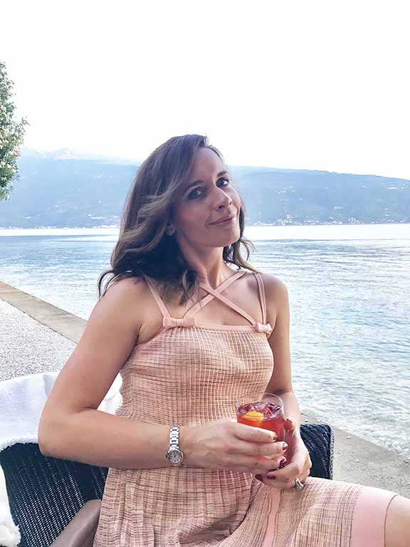 Petra Brisby of Chic Journal blog enjoying drink at Villa Feltrinelli