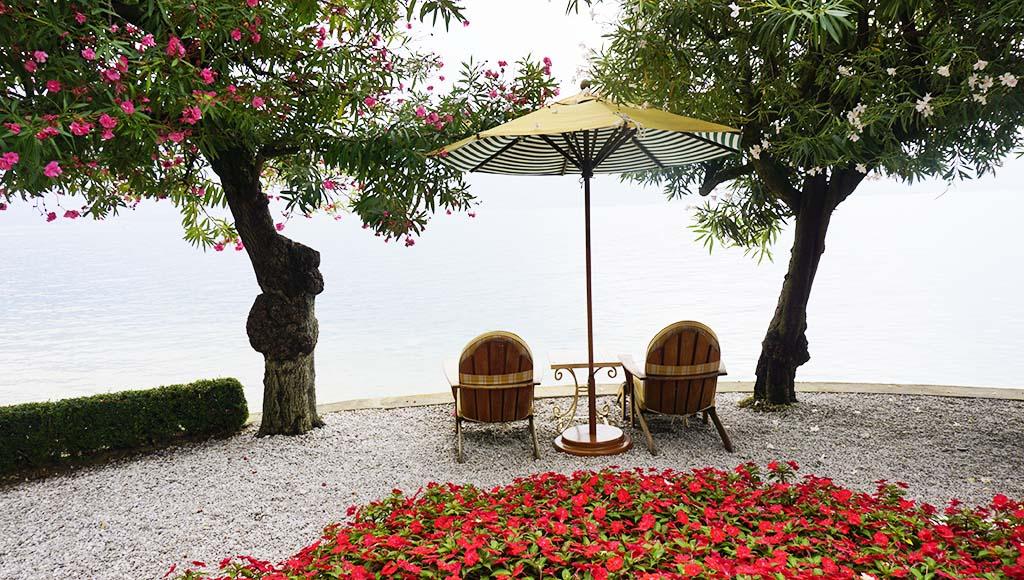 Lounges in the garden of Villa Feltrinelli Lake Garda Italy