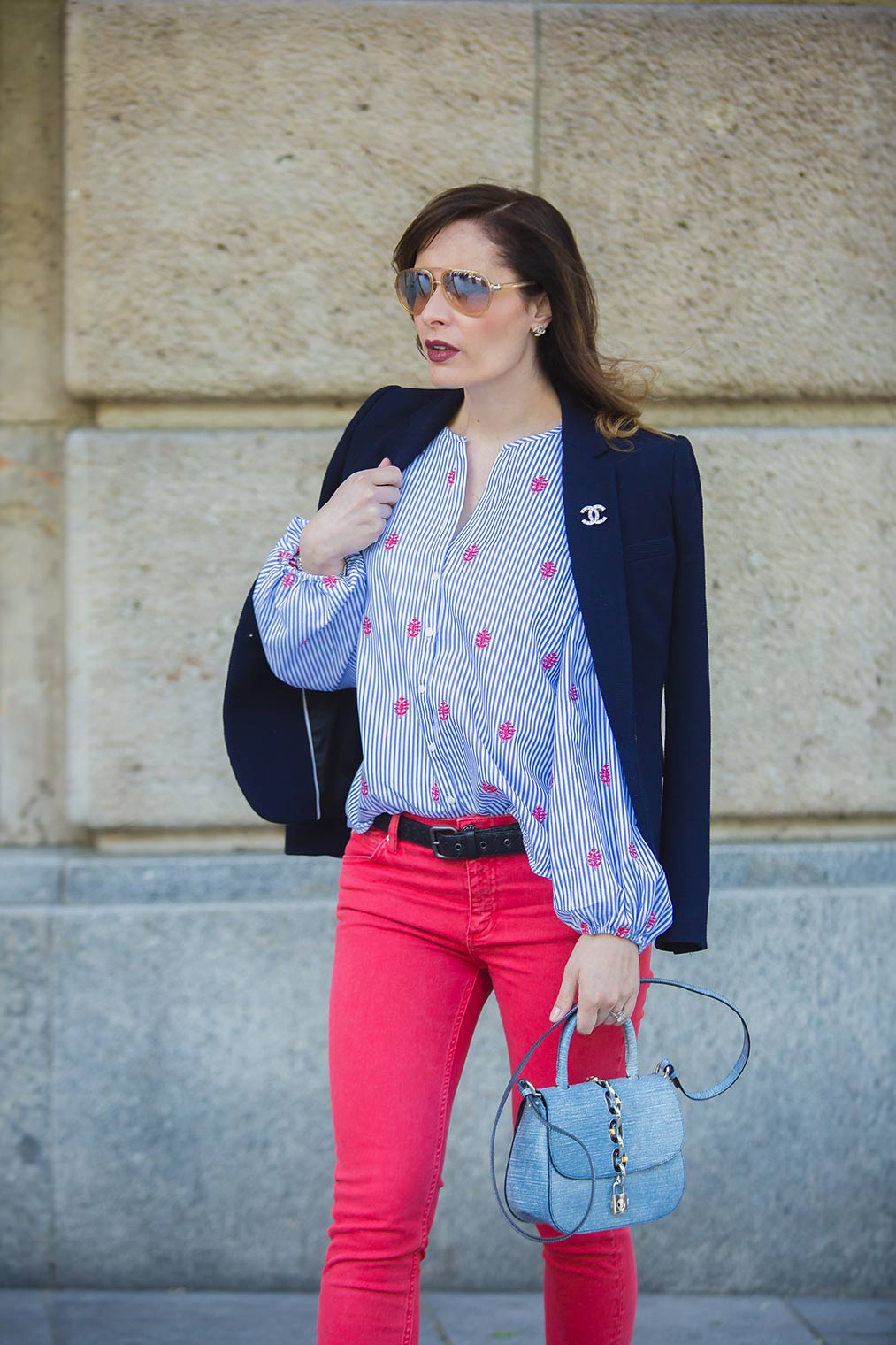 Louis Vuitton bag and red jeans