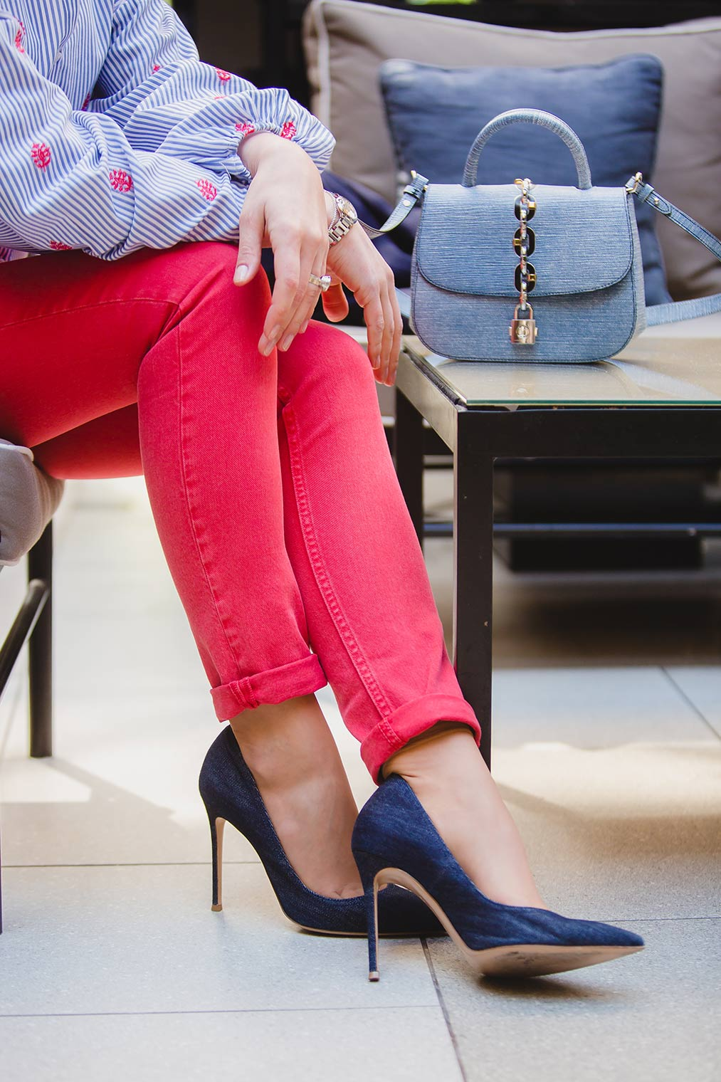 Gianvito Rossi pumps, red jeans and Louis Vuitton bag