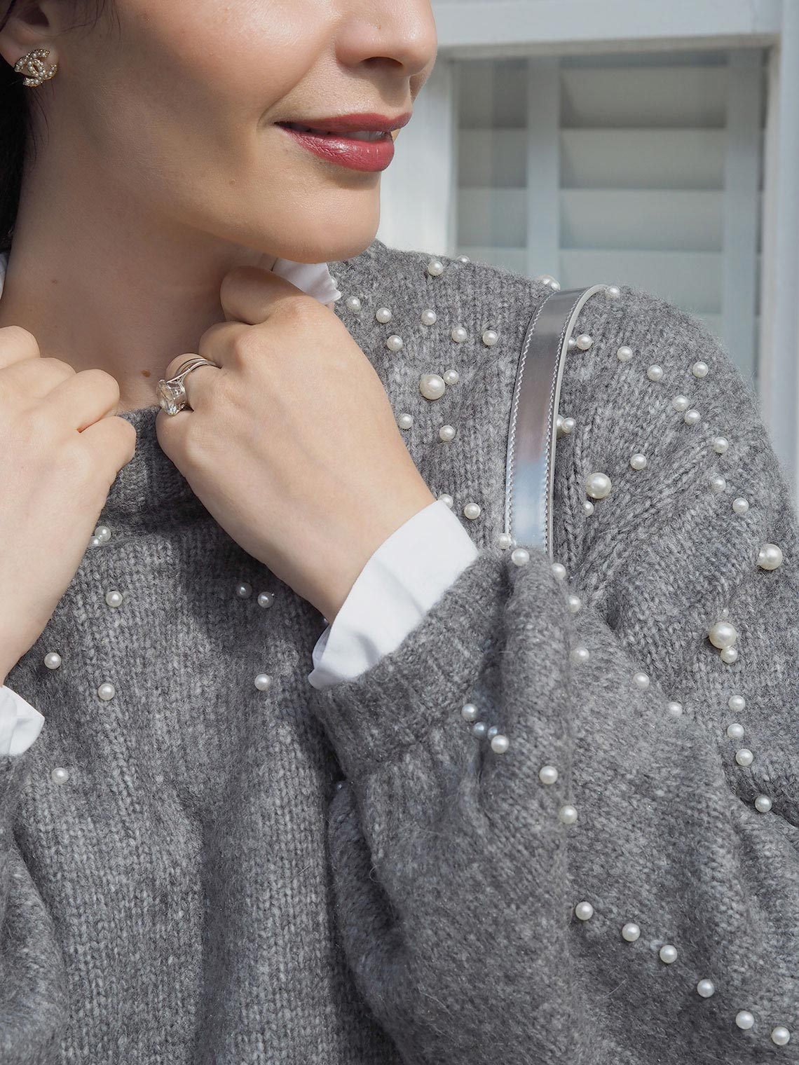 Knitwear trends grey sweater with pearls embellishment