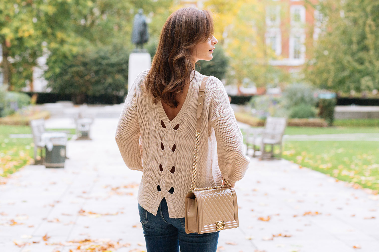 beige sweater with the detail on the back