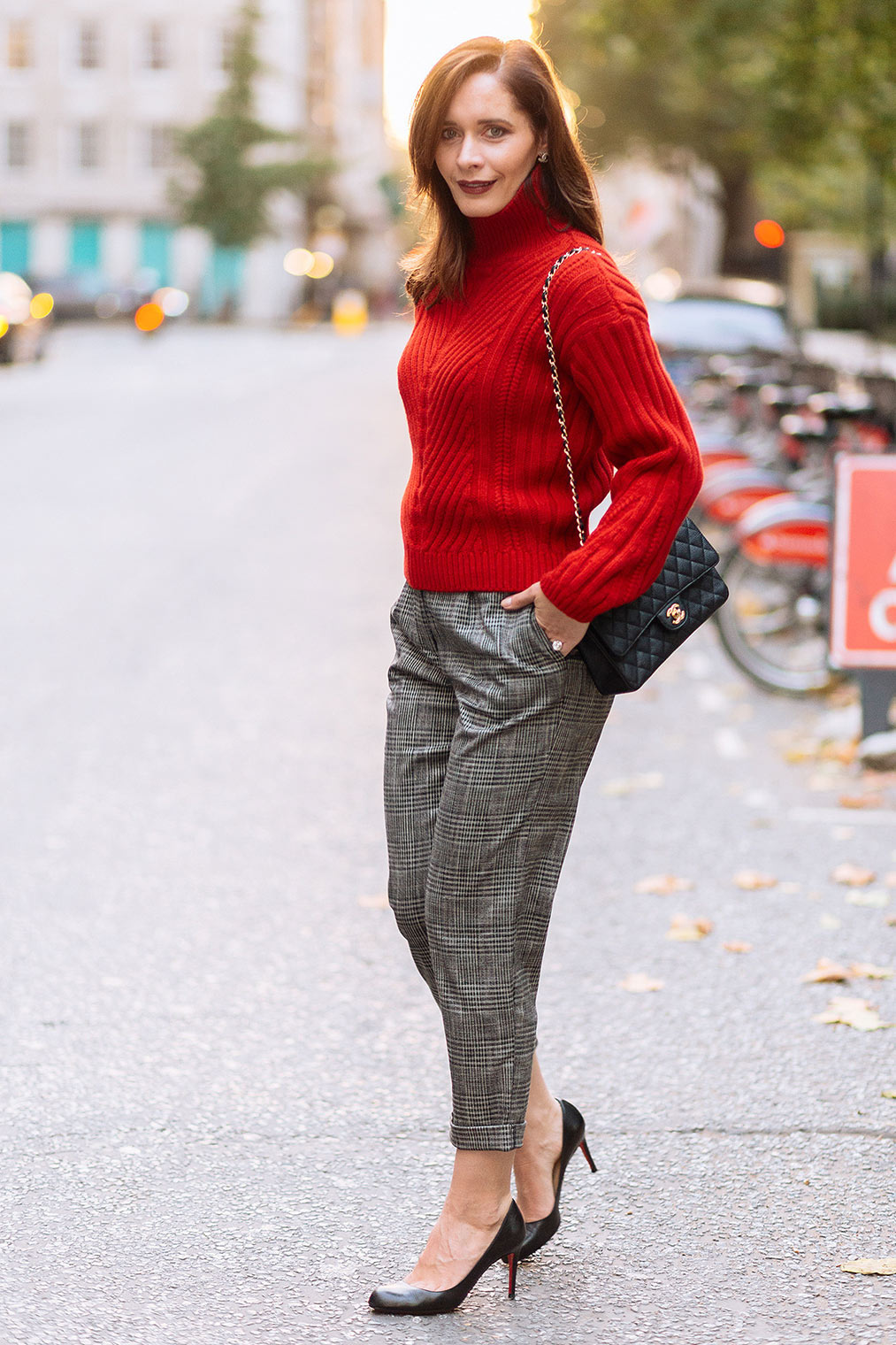 Red sweater and checked trousers fall 2017
