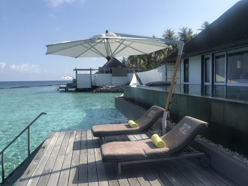 Cheval Blanc Maldives water villa terrace with sun lounges