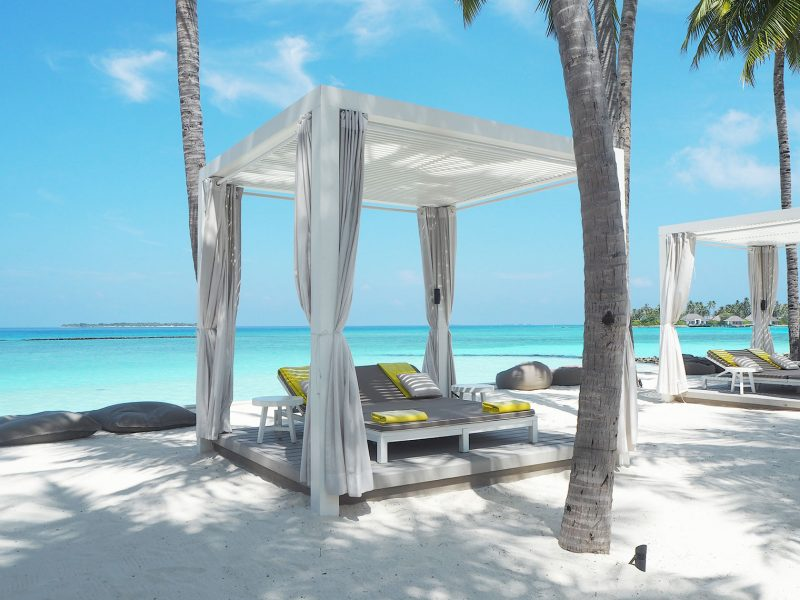 Sun lounges by the main pool Cheval Blanc Maldives