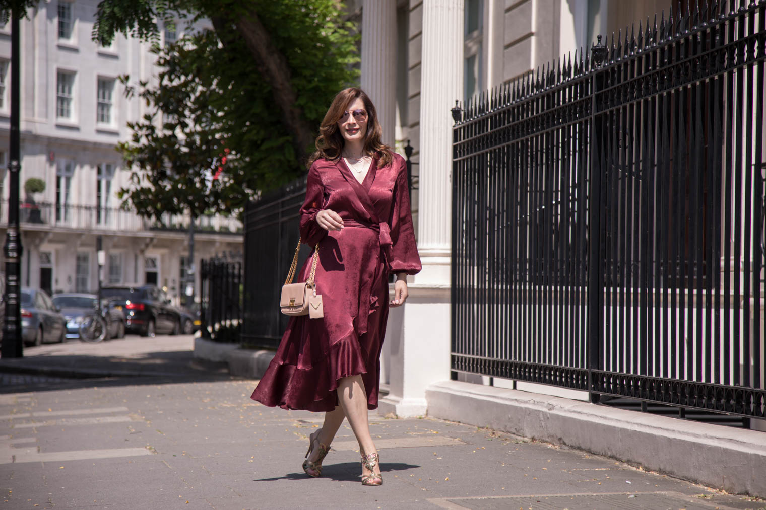 Petra from Chic Journal wearing burgundy wrap dress