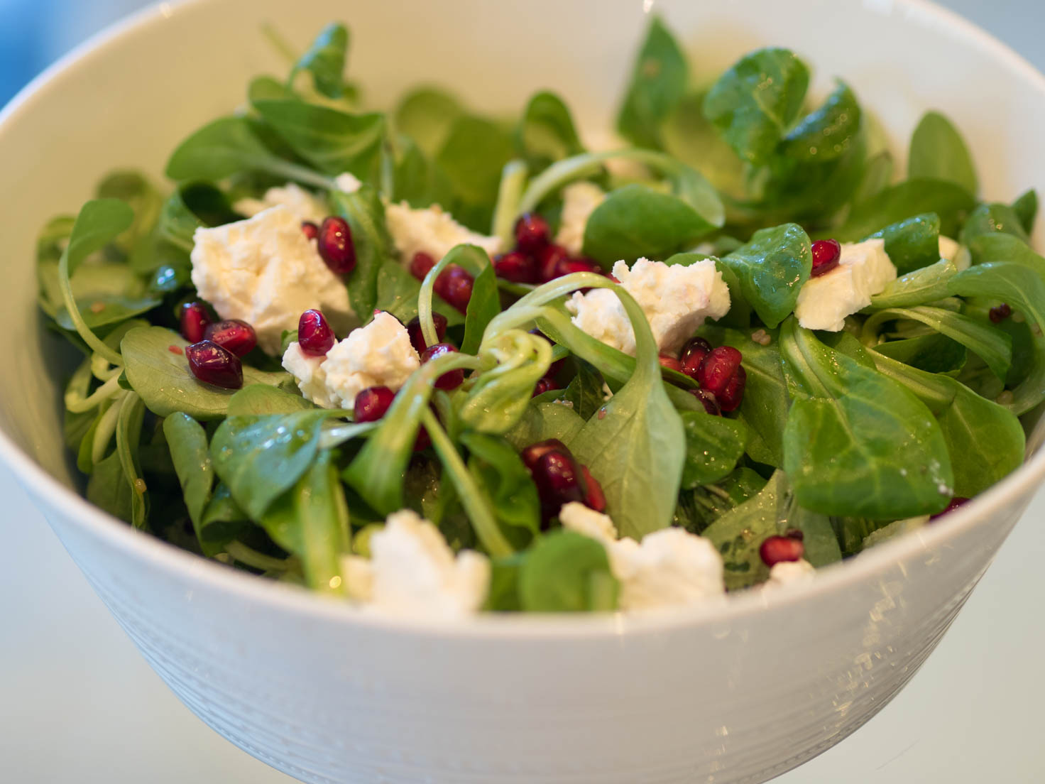 Lamb lettuce, quinoa, feta cheese and pomegranate seeds