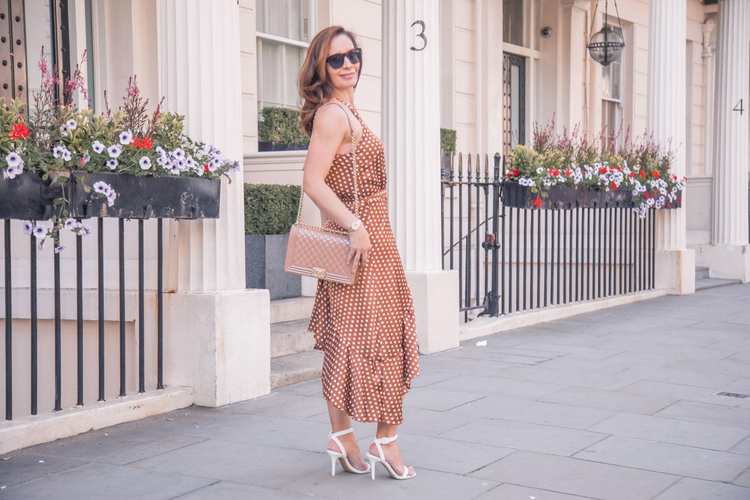 Asymmetrical polka dot dress worn by Chic Journal's Petra
