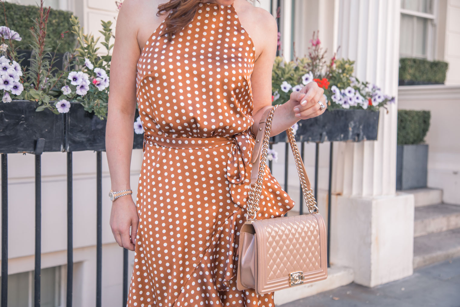 Polka dot dress by Forever Unique and Chanel handbag