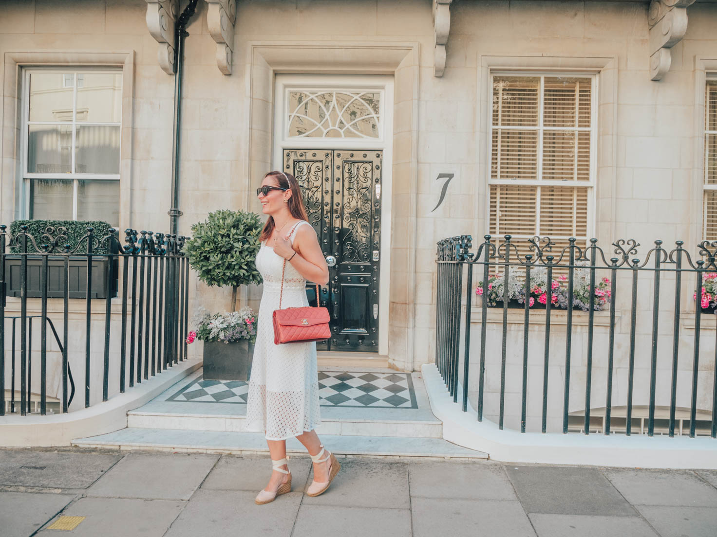 Chic Journal's Petra wears lace midi white dress by Sandro and Chanel pink handbag