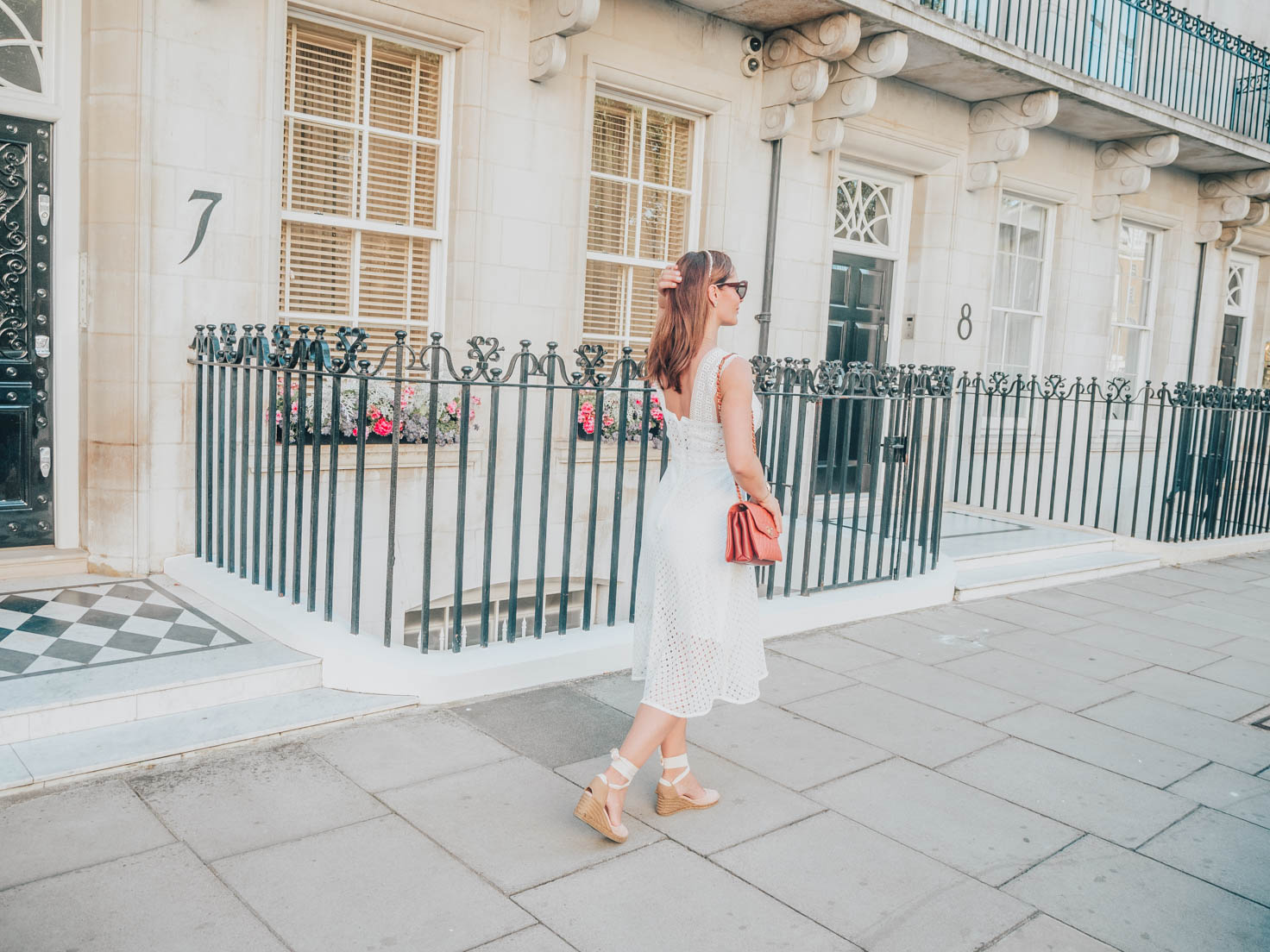 Petra from Chic Journal wearing Sandro white dress and Castaner espadrilles
