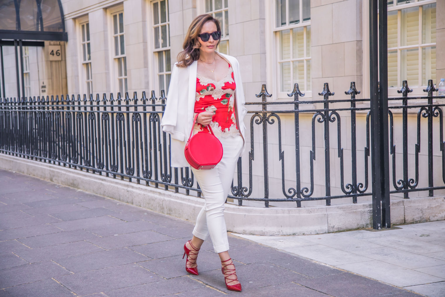 How to dress up white trousers with lace Dolce & Gabbana top
