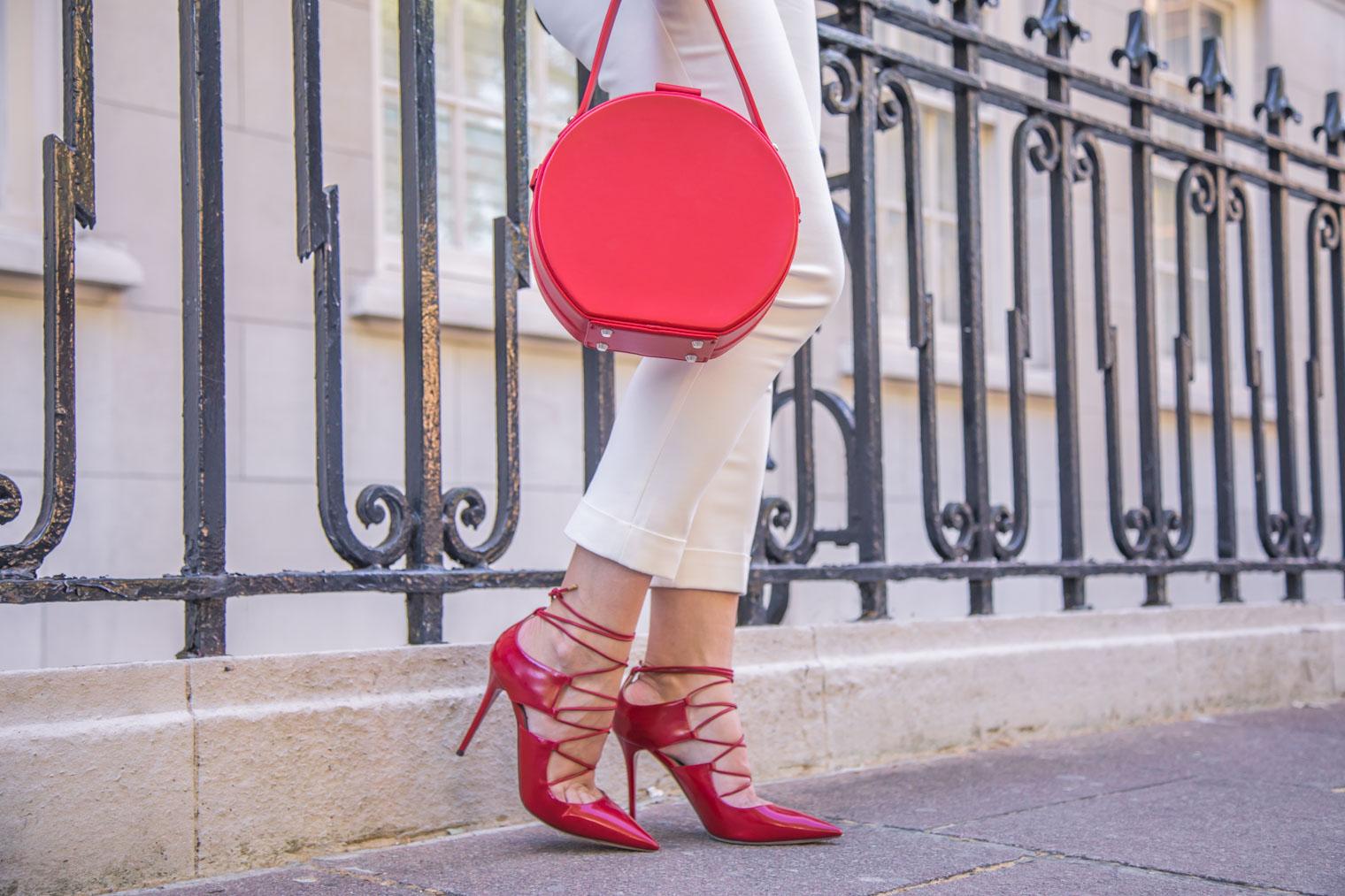 Prada white trousers, Red Jimmy Choo heels and Nico Giani bag
