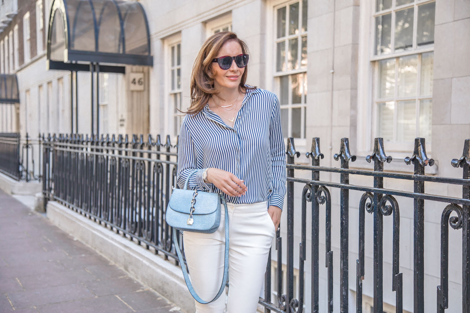 White trousers and stripy shirt with Louis Vuitton Chain It Bag