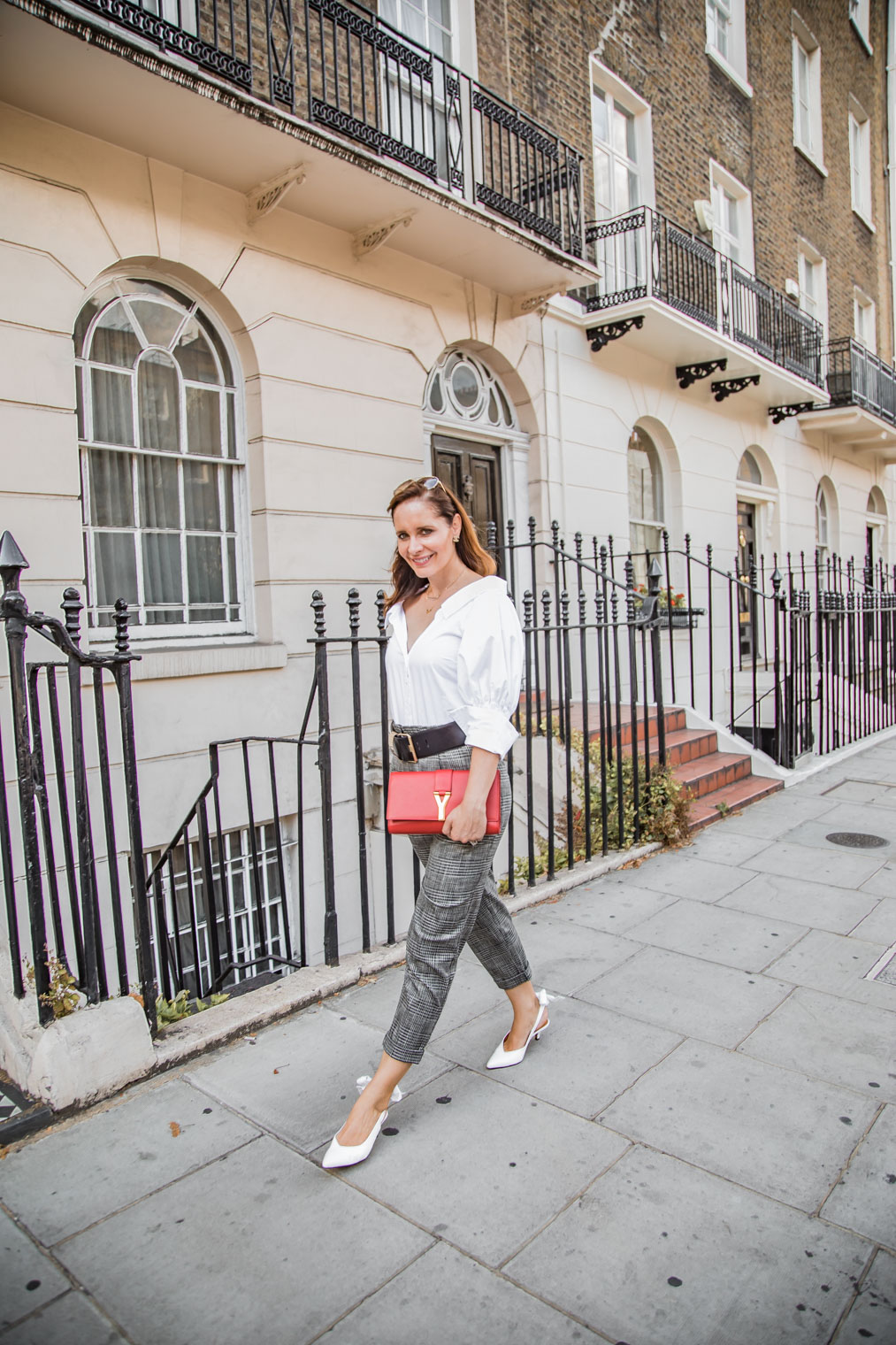 White slingback shoes and checked trousers