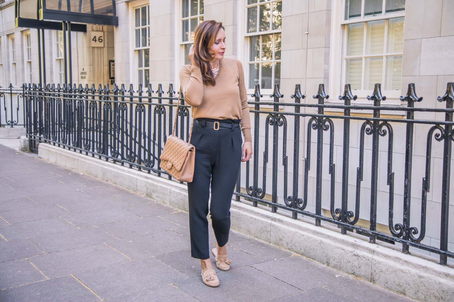 black Paperbag trousers with Uniqlo sweater and Chanel bag
