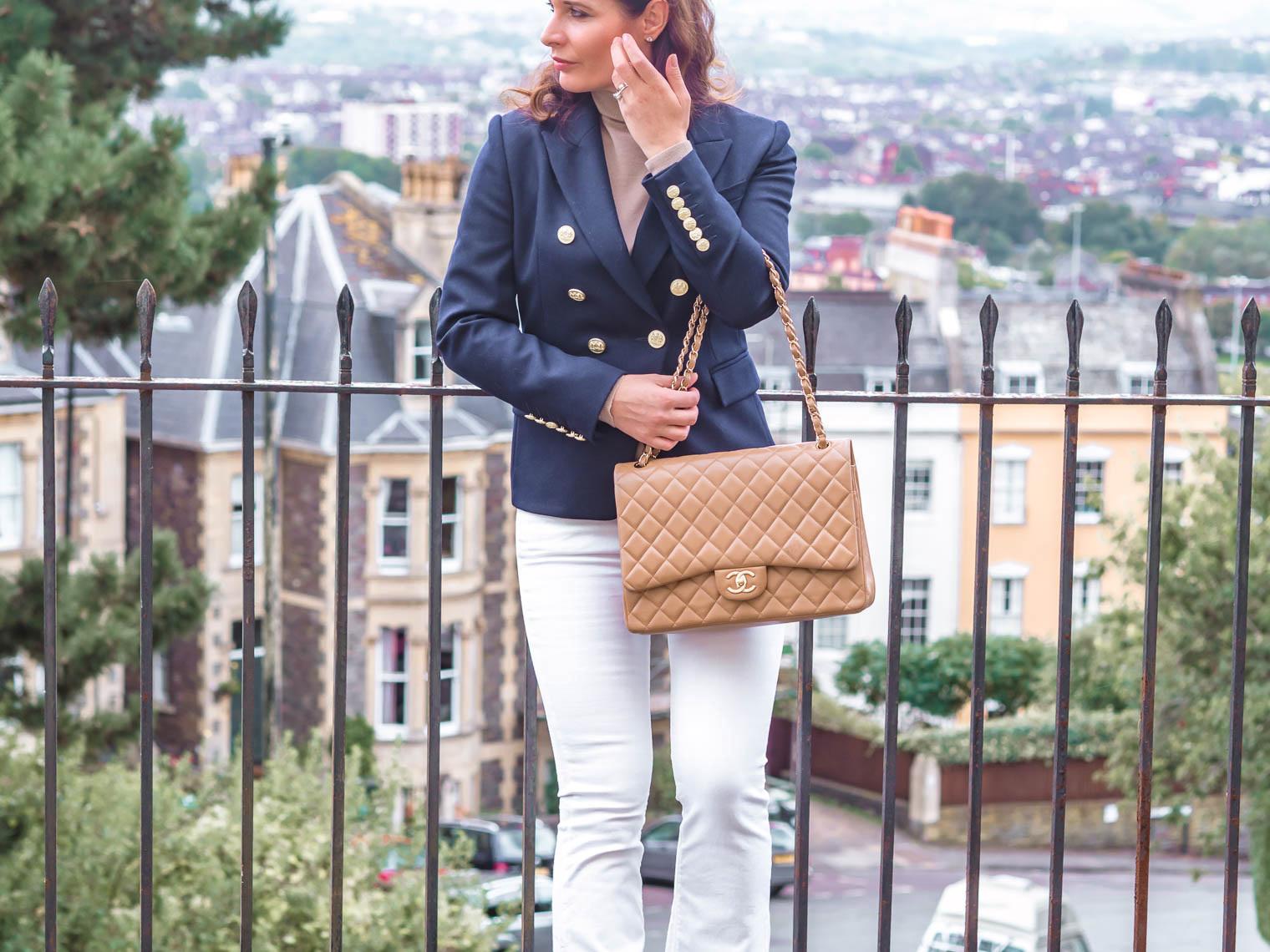 Holland Cooper jacket white jeans large Chanel flap bag uniqlo turtleneck camel