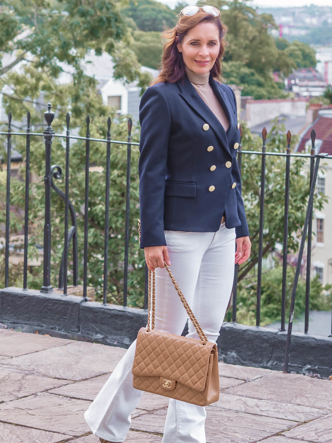 Chic Journal blogger wearing navy blue Holland Cooper jacket white flare jeans Chanel large flap bag
