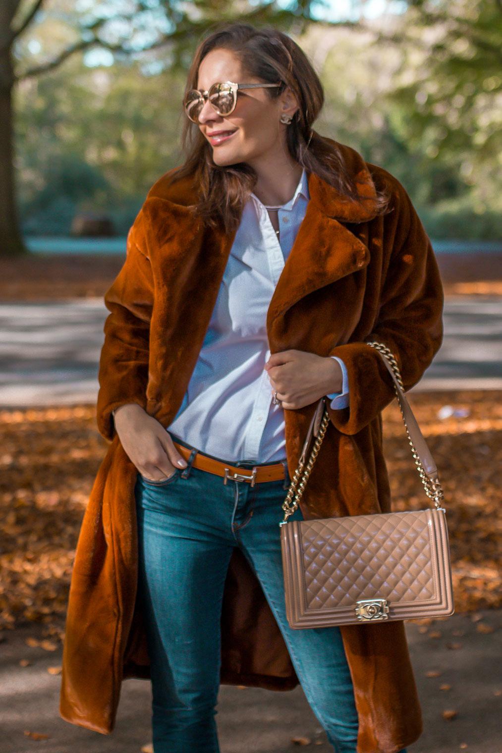 Faux fur coat Chanel boy bag Tods orange belt Linda Farrow sunglasses