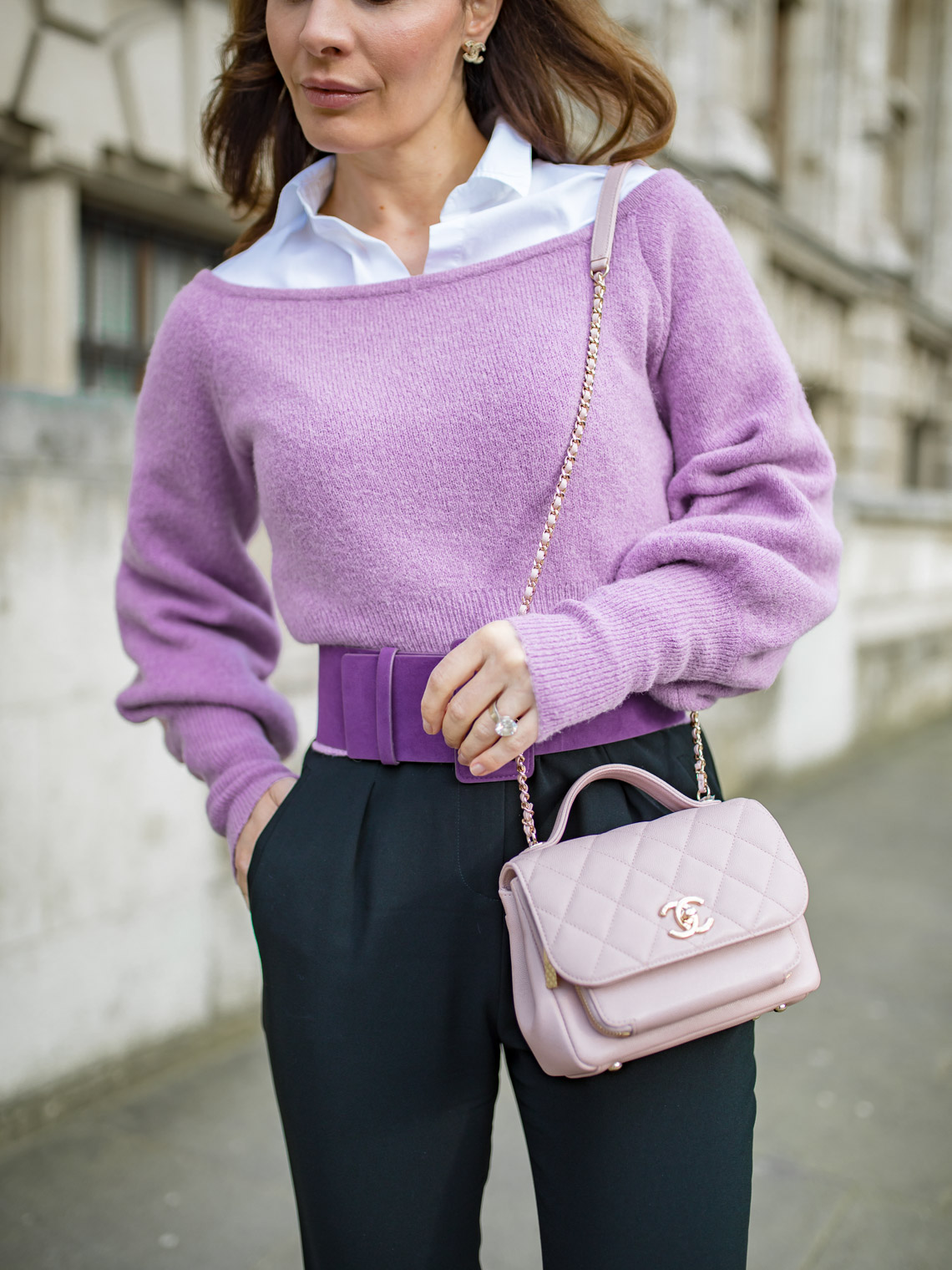 Off the shoulder purple sweater with white shirt and pink Chanel bag