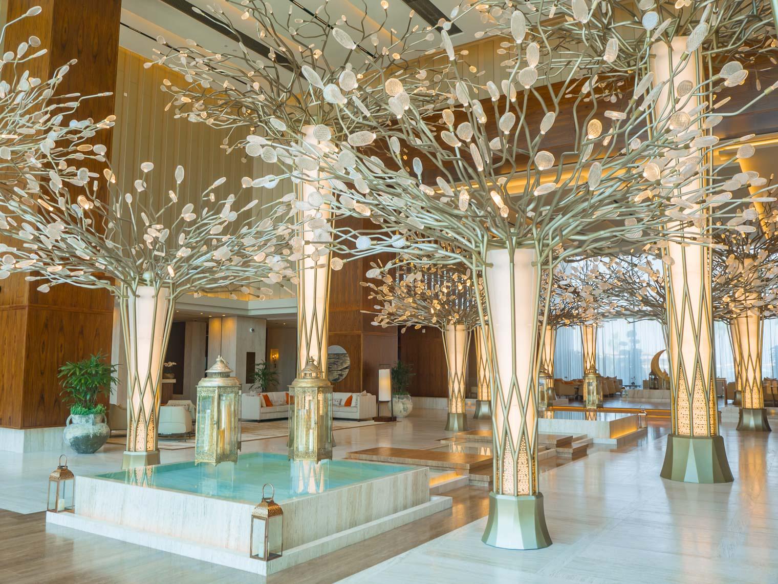 Mandarin Oriental Jumeira Dubai lobby bronze trees