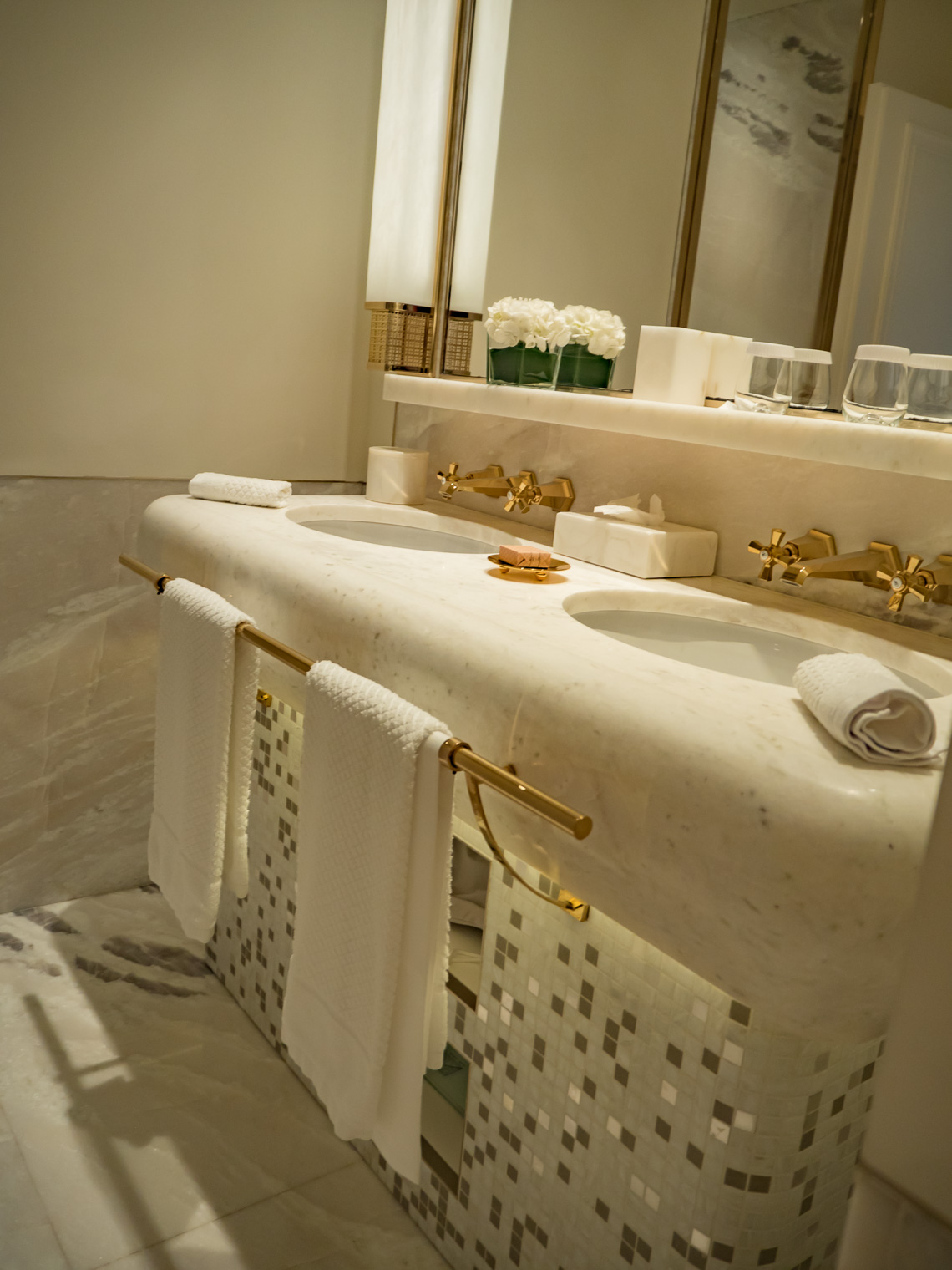 Luxury bathroom white marble with gold taps at hotel Eden Rome