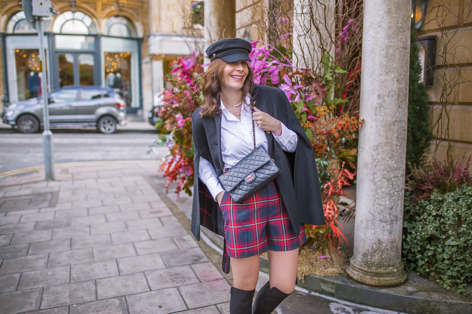 Black cape coat with checked shorts